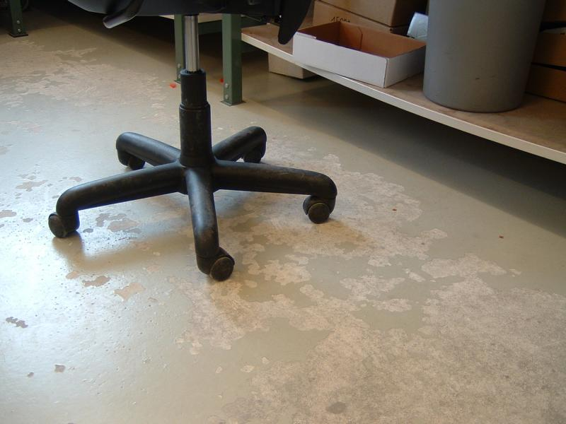 Expert's opinion on the abrasion due to chair castors in a depot in Munich
